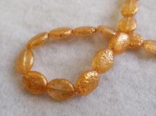 Splatter Glass Bead Oval 9x11mm Gold +/-35pcs
