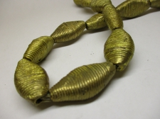 AFRICAN BRASS BEADS 35X17X10MM +/-52CM