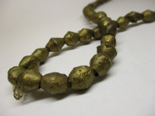 AFRICAN BRASS BEADS 10X10MM +/-50CM